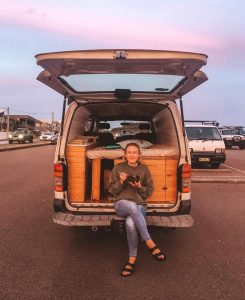 Lexi Crouch in her campervan fitted out using 100% reclaimed and recycled materials